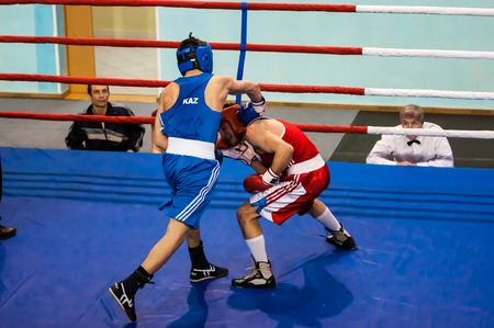 colonel: Orenburg, Russia - 29 April 2015: Fight boxers on All-Russian tournament in boxing among Juniors 1997-98 born in memory of Lieutenant Colonel of militia who died tragically A.T. Kayumova Editorial