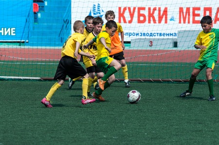 football play: Orenburg, Russia - 22 May 2015: Children play football at the competition Lokobol-2015.