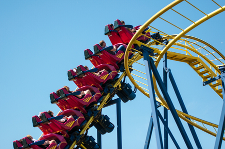 entertain: Orenburg, Russia - 23 May 2015: Roller coaster attraction to entertain children and adults