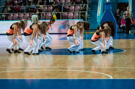 squad: Orenburg, Russia - 14 October 2015: Girls cheerleading appear on basketball parquet at the match Nadezhda (Orenburg) and Girona (Spain)