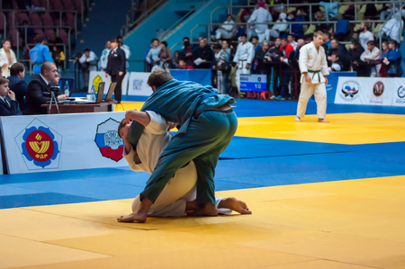 wrestlers: Orenburg, Russia - 31 October 2015: Boys wrestlers compete at the tournament in memory of Victor Chernomyrdin.