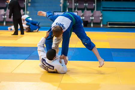 wrestlers: Orenburg, Russia - 30 October 2015: Boys wrestlers compete at the tournament in memory of Chernomyrdin.