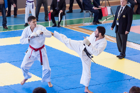 compete: Orenburg, Russia - 28 November 2015: Boys compete in karate