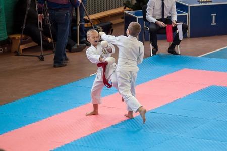 karateka: Orenburg, Russia - 28 November 2015: Children compete in karate