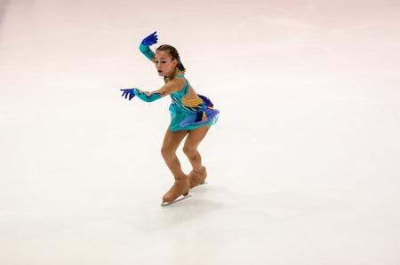 figure skater: Orenburg, Russia - 26.03.2016: Competitions girls figure skater Orenburg expanses. Editorial