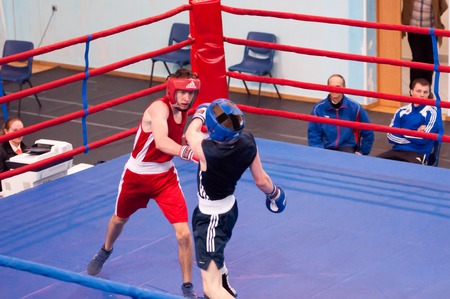 compete: Orenburg, Russia - 28 April 2016: Boys boxers compete the tournament among Juniors the memory of A.T. Kayumova