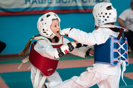 compete: Orenburg, Russia - 23 April 2016: Girls compete in taekwondo on Championships city among girls 2005-2007 years of birth.