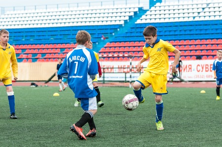 football play: Orenburg, Russia - 1 June 2016: The boys play football in the preliminary games football festival Lokobol-2016