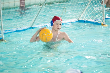 waterpolo: Orenburg, Russia - 6 May 2015: The boys play in water polo on City tournament