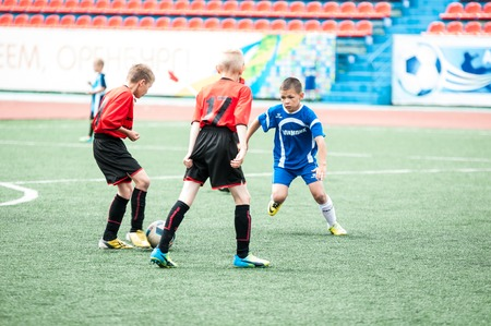 Orenburg, Russia - 1 June 2016: The boys play football in the preliminary games football festival Lokobol-2016
