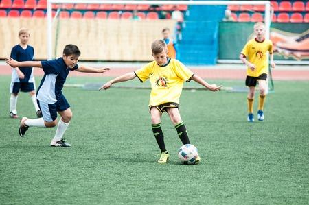 preliminary: Orenburg, Russia - 1 June 2016: The boys play football in the preliminary games football festival Lokobol-2016