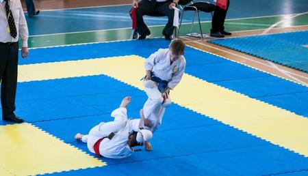 compete: Orenburg, Russia - 28 November 2015: Boys compete in karate at the Open Championship Orenburg