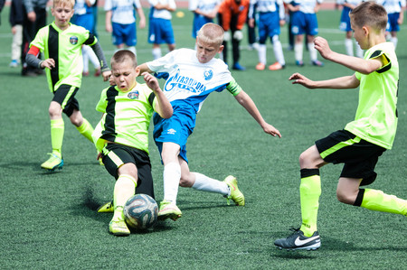 football play: Orenburg, Russia - 1 June 2016: The boys play football in the preliminary games football festival Lokobol-2016.