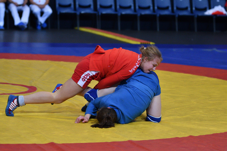 Orenburg, Russia - 29 October 2016: Girls compete in Sambo in the Championship of Russia in Sambo among boys and girls born 2000-2001 biennium of birth Editorial