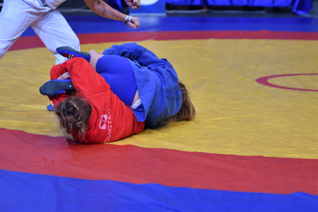 sambo: Orenburg, Russia - 29 October 2016: Girls compete in Sambo in the Championship of Russia in Sambo among boys and girls born 2000-2001 biennium of birth Editorial