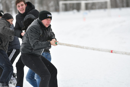 Orenburg, Russia-January 26, 2017 year: Students compete in the tug-of-war in the winter games, dedicated to Day students Editorial