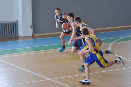 Orenburg, Russia - 15 May 2015: Boys play basketball for the Cup High School Basketball League