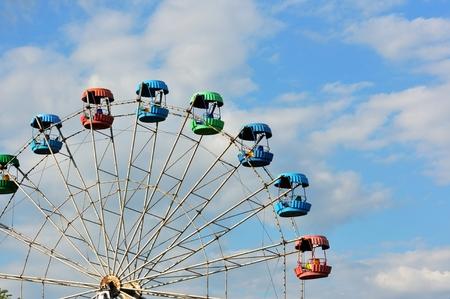 Ferris wheel in a summer amusement park Stock Photo