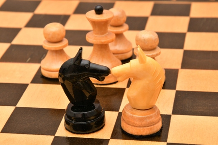 intention: The concept of business take the right decision. Chess piece on a chessboard