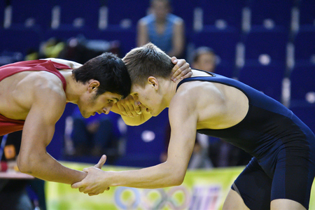 Orenburg, Russia - March 16, 2017 year: Boys compete in freestyle wrestling on privolzhskiy Federal District Championships among boys 2001-2000 biennium of birth