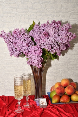 white wine: Wedding goblets, wedding rings and flowers of lilac