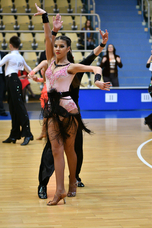 Orenburg, Russia - December 11, 2016: Girl and boy dancing at the Open Championship and the cup of Orenburg in sport dancing Editorial