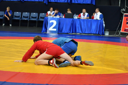 wrestle: Orenburg, Russia - 29 October 2016: Boys competitions Sambo in the Championship of Russia in Sambo among boys and girls born 2000-2001 biennium of birth