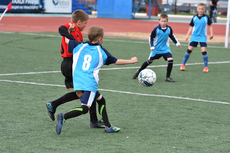 freetime: Orenburg, Russia - May 28, 2017 year: The boys play football in the preliminary games football festival Lokobol-2017