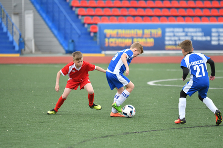 Orenburg, Russia - May 28, 2017 year: The boys play football in the preliminary games football festival Lokobol-2017