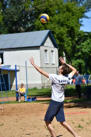 Orenburg, Russia, 9-10 June 2017 year: Boys playing beach volleyball on City tournament Beach Volleyball «Golden Sands» Editorial