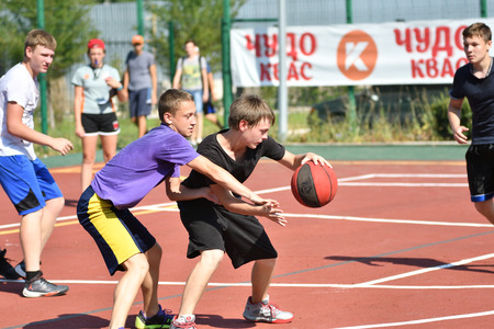 street shot: Orenburg, Russia - July 30, 2017 year: men play Street Basketball in the second round of the summer Street Basketball League Editorial