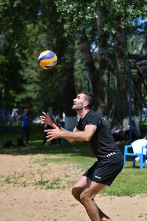 Orenburg, Russia, 9-10 June 2017 year: Boys playing beach volleyball on City tournament Beach Volleyball Golden Sands Editorial
