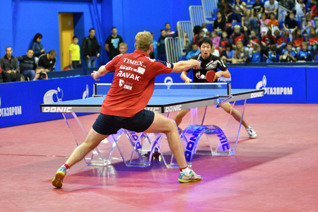 Orenburg, Russia - September 28, 2017 years: boy compete in the game table tennis  the European champions League match in table tennis mens curling among the mens teams TORCH- GAZROM , Russia and K.S. DARTOM DJGORIA GRODZISR, Poland.