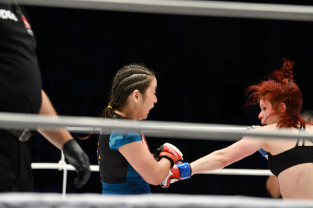 Orenburg, Russia - June 15, 2018 year: The girls fighters compete in mixed martial arts (M-1 Challenge 94) at tournament The battle in the heart of the continent