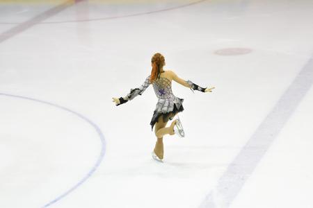 Girl skater skates on ice sports arena 版權商用圖片