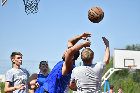 Orenburg, Russia - July 30, 2017 year: men play Street Basketball in the second round of the summer Street Basketball League Editorial