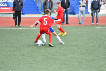Orenburg, Russia - May 28, 2017 year: The boys play football in the preliminary games football festival