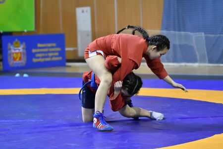 Orenburg, Russia - February 16, 2019: girls competitions Self-defense without weapons in the Championship of the Orenburg region by Sambo among boys and girls born 2003-2004 biennium of birth Editorial