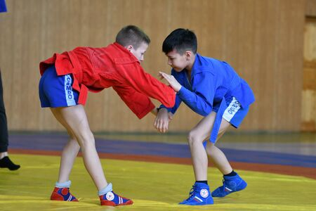 Orenburg, Russia - February 23, 2019: Boys competitions Self-defense without weapons on the Championship school sports No. 1 name L.D. Kovalevsky by Sambo among young men 2005-2006 years of birth.