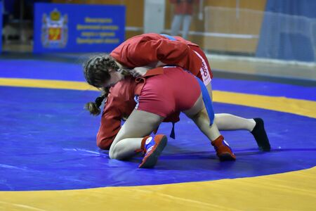 Orenburg, Russia - February 16, 2019: girls competitions Self-defense without weapons in the Championship of the Orenburg region by Sambo among boys and girls born 2003-2004 biennium of birth Редакционное