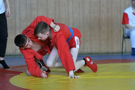 Orenburg, Russia - February 23, 2019: Boys competitions Self-defense without weapons on the Championship school sports No. 1 name L.D. Kovalevsky by Sambo among young men 2005-2006 years of birth. Archivio Fotografico - 131740231