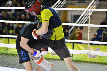 Orenburg, Russia - February 18, 2017 year: The fighters compete in mixed martial arts in the Championship of the Orenburg region on mixed martial arts Standard-Bild - 128907928