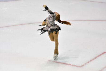 Girl skater skates on ice sports arena 写真素材 - 129373497