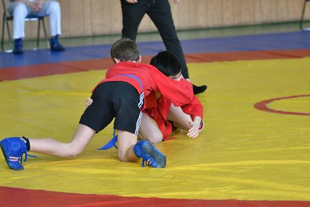 Orenburg, Russia - February 23, 2019: Boys competitions Self-defense without weapons on the Championship school sports No. 1 name L.D. Kovalevsky among young men 2005-2006 years of birth.