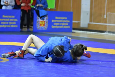 Orenburg, Russia - February 16, 2019: girls competitions Self-defense without weapons in the Championship of the Orenburg region among boys and girls born 2003-2004 biennium of birth Редакционное