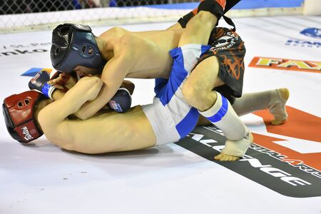 Orenburg, Russia - February 18, 2017 year: The fighters compete in mixed martial arts (MMA) in the Championship of the Orenburg region on mixed martial arts Редакционное