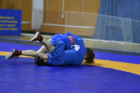 Orenburg, Russia - February 16, 2019: girls competitions Self-defense without weapons in the Championship of the Orenburg region among boys and girls born 2003-2004 biennium of birth 報道画像