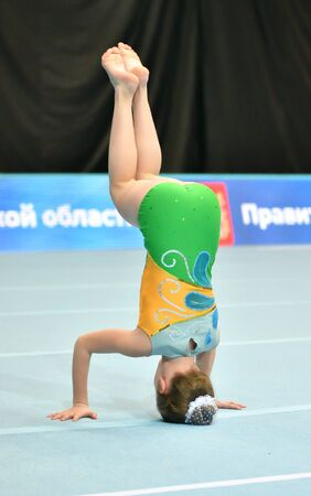 Orenburg, Russia, December 14, 2017 year: girl compete in sports acrobatics at the Open Championship in sports acrobatics 報道画像