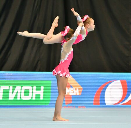 Orenburg, Russia, December 14, 2017 year: girl compete in sports acrobatics at the Open Championship in sports acrobatics 写真素材 - 131742939
