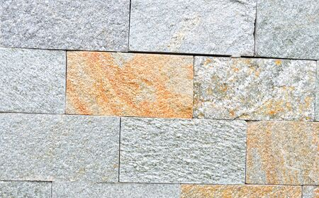 The texture of the building material from which the wall is built